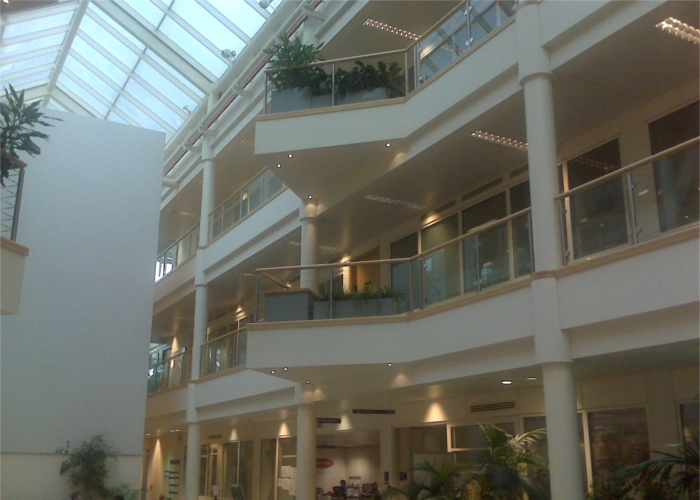 High level internals of a glass roof and atrium glass balustrade cleaning