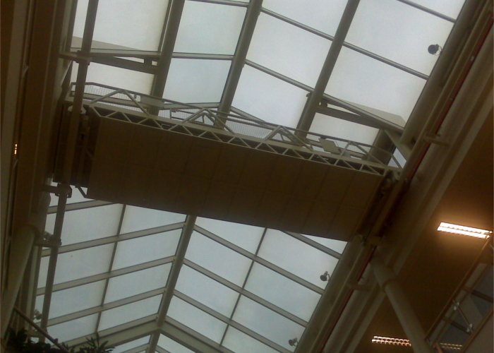 Cleaning internal glass roof from a moving gantry