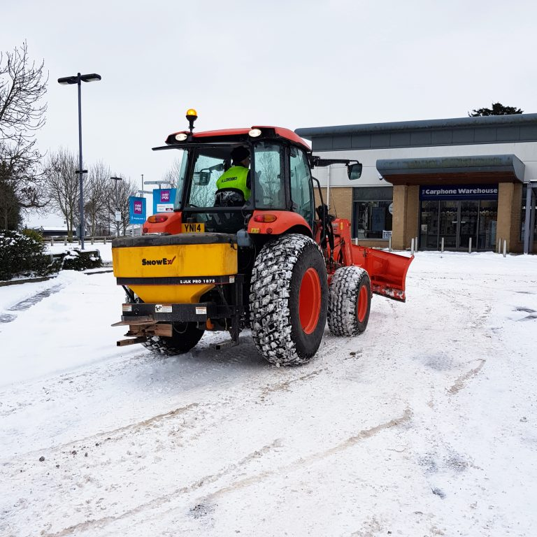 Tractor mounted snow plough and gritter for clearing snow from public areas