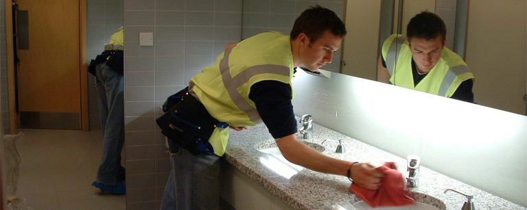 Commercial cleaning toilets in an office block