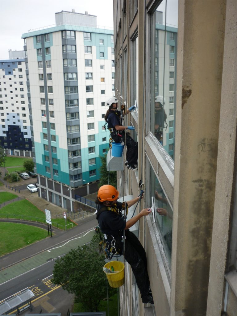Cleaning windows using rope access