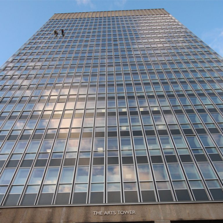 Window cleaning high rise building using rope access