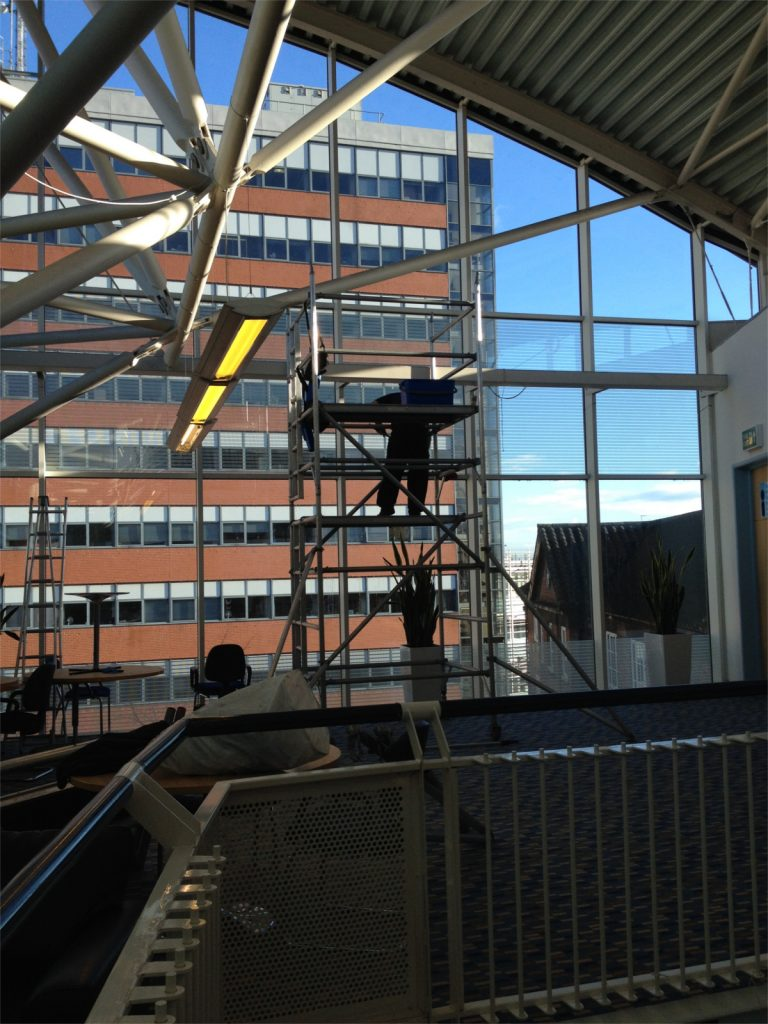 High level internal glass cleaning using a tower scaffold
